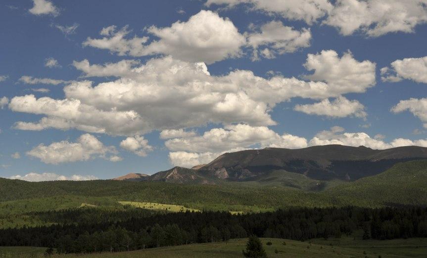 Clouds Cast Dark Shadows over Mountain Valley